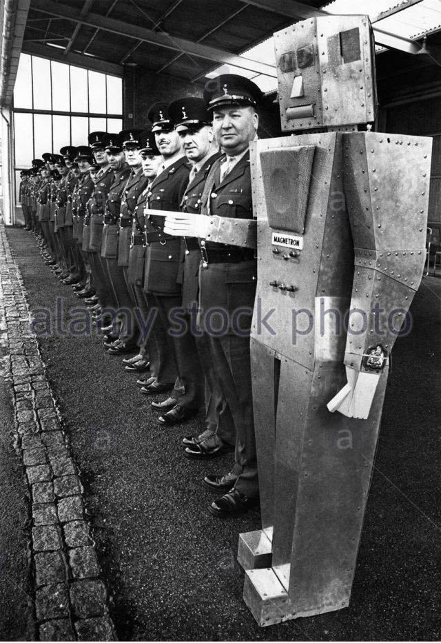 sargeant-majors-lining-up-with-robot-on-the-end-1968-x640
