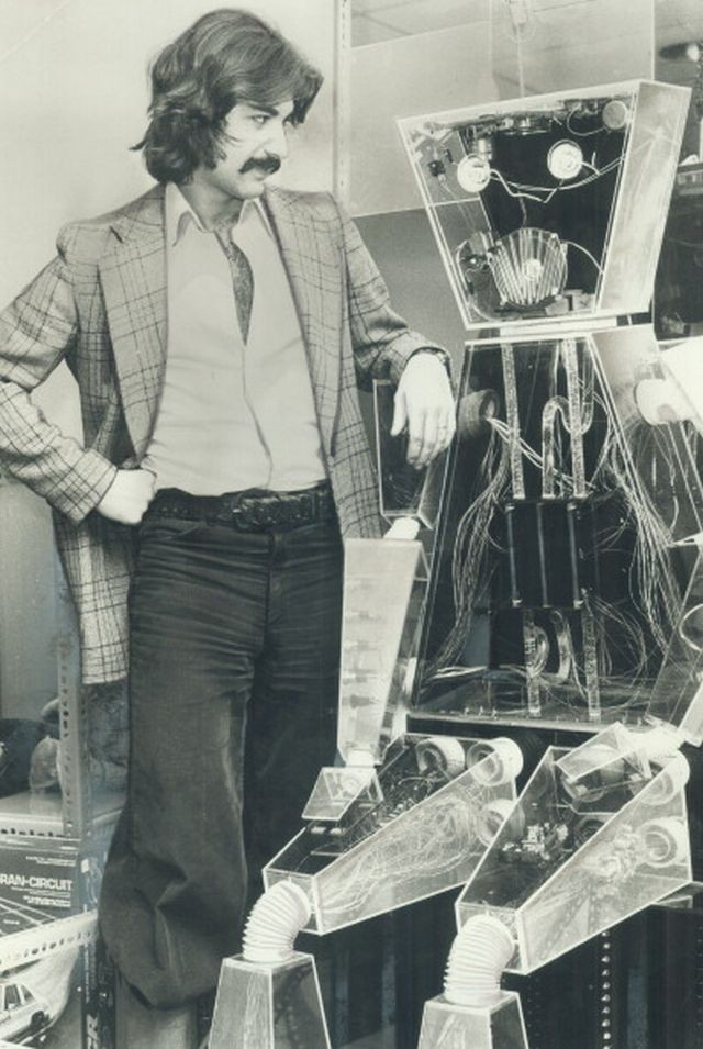 Robbie the Robot with his master Simon Henri; 25; keep children amused in the toyland at The Bay on